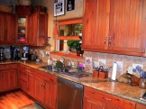 Kitchen with custom Alder cabinetry.