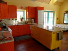 Colorful custom cabinets in Guest House kitchen.