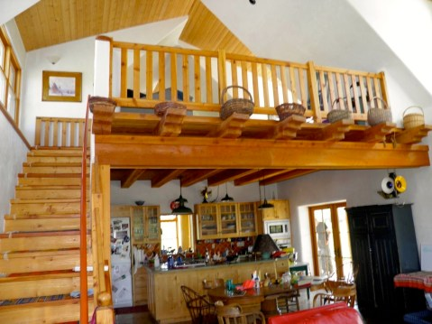 Custom kitchen under second floor sitting area.