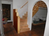 AFTER: A new, comfortable winder stair with a Mahogany and Maple half wall.