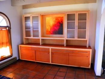 """Custom made Mahogany and Maple buffet in Dining Room. """"Rain Glass"""" Maple doors on upper cabinet."""