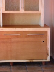 Custom made Mahogany cabinet. Sliding door with custom copper finger pull detail.
