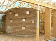 Curved Adobe wall in Master Bedroom under construction.