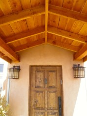 Front door under Douglas Fir Portal.