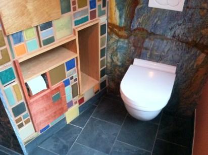Pewabic tile mosaic on custom cabinetry.