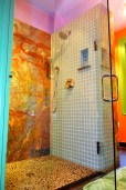 """Glass tile with """"Blue Louise"""" granite in walk in shower."""
