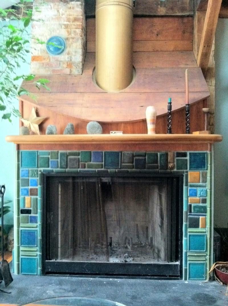 Pewbic tile surround on custom fireplace.