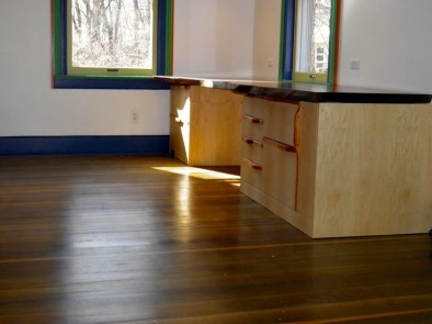 Maple desk with Spanish Cedar pulls. Black Walnut top with live edge.