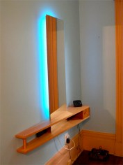 Custom made wall hung phone table with mirror, by Architect John Bogner.