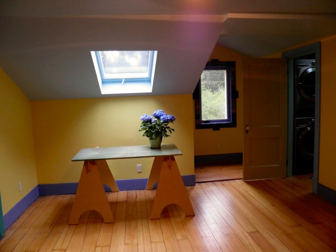 Renovated Guest Room with new skylight and window with Pewabic tile trim.