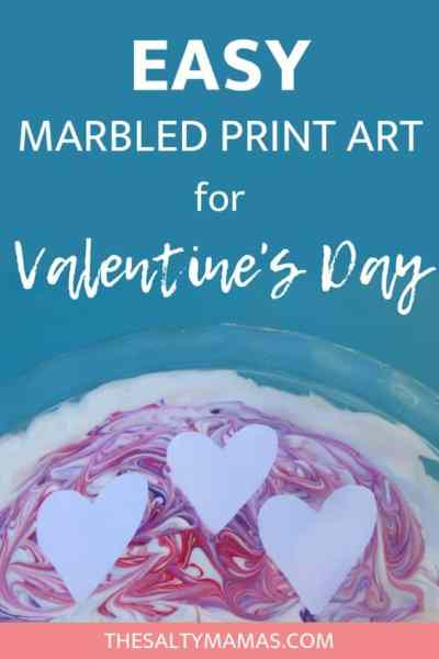 Celebrate Valentine's Day with your kids with this adorable heart shaped, marbled shaving cream art. Kids will swirl colors before creating beautiful, swirling hearts. Get the full instructions for this process based Vaelntine's Day art project at TheSaltyMamas.com. #valentinesday #valentinesdayart #valentinesdaycraft #artforkids #kidsart #valetninesdaytraditions #artfortoddlers #toddlerartprojects