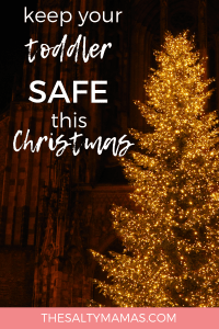 Wondering how to keep a toddler away from the Christmas tree? Or how to baby-proof your Christmas decorations? Find the safety tips you need this holiday season at TheSaltyMamas.com. #toddlers #baby #babies #christmas #holidaysafety #mom #parenting #kids #holidays #holiday #christmasdecorations