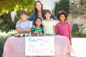mom helping kids at a bake sale