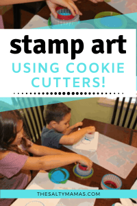 kids use cookie cutters and blue paint to make process art