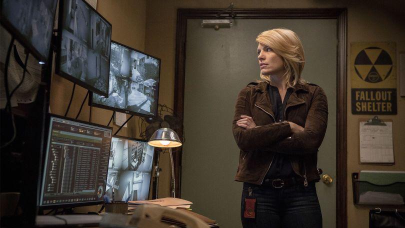 Jennifer stares at surveillance monitors