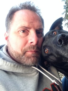 AP history teacher Bill Schrier takes a selfie with his dog, Roxi, at Carmel beach, one of their favorite spots.