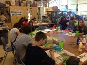 Ms. Bev's Art I students prepare water color wave and surfer paintings that tie into the show's west coast theme.