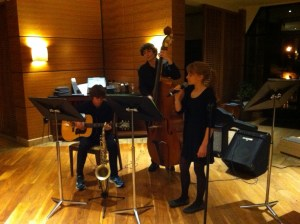 CHS musicians Michael Montgomery and Ari Freedman play at the Hyatt on Jan. 6 with CMS singer Pascale Montgomery.