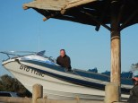 Wayne Marsh prepares to take another load of eager tourists charging around the ocean in search of marine life.