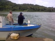 Fishing from the jetty down at the Umzimkulu Marina, Mike and Brian focused on a fish