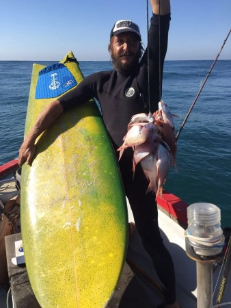 Roosta with his catch of the day! Hope he ain't paddling around with lot in tow?!?