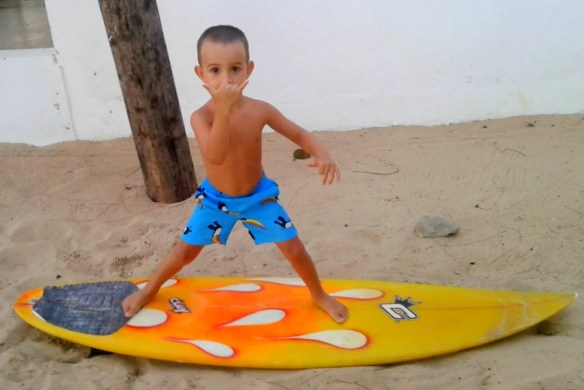 Oh oh, better catch some waves now before he grows up