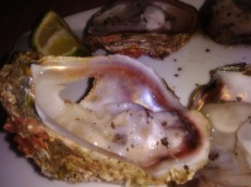Gulp down an oyster or two at ZanziBeach on the beach of Tofo