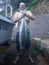 Matt Wainwright and his 15kg 'couta caught with a live mackeral