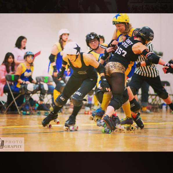 Roller derby girl hitting hard