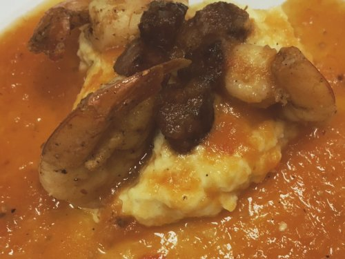 Shrimp and Grits with Crispy Knackwurst and Tomato Jus