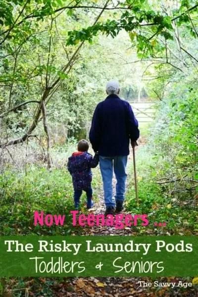 Grandchild and grandparent walk in woods.