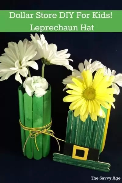 Two popsicle stick vases with flowers and popsicle stick leprechaun hat.