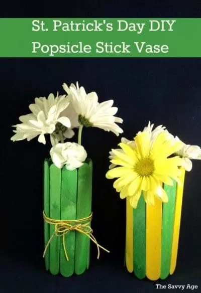 Green popsicle stick vase and green and yellow popsicle stick vase with white flowers for St. Patrick's Day.