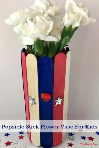 Easy popsicle stick craft for kids! Enjoy the red, white and blue holidays using the dollar store, your garden and recyclable cans and bottles to make these cute little vases.