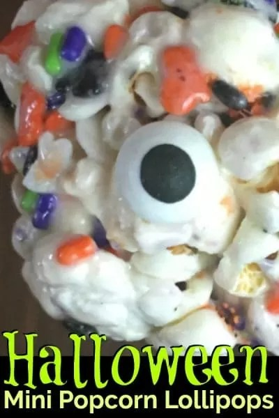 close up of a Halloween popcorn ball with a candy eyeball