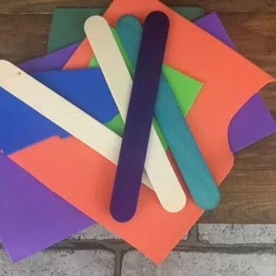 Multi colored craft paper and popsicle sticks.