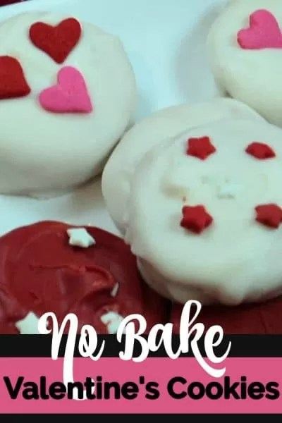 Valentine's cookies with red, and white chocolate decorated with red and pink hearts.