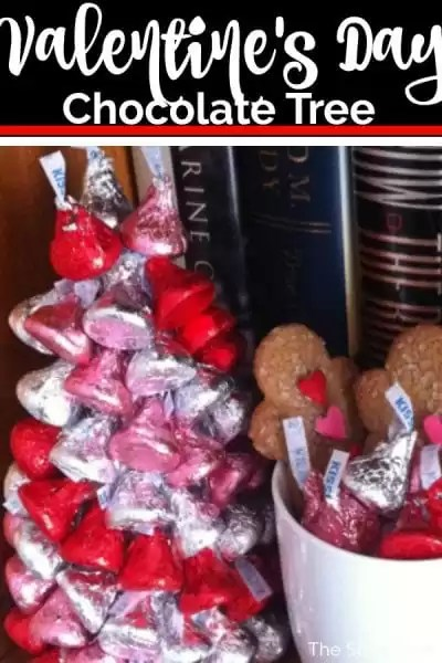 Valentine's Day chocolate tree made of red, pink and white hershey kisses sitting on a bookshelf.