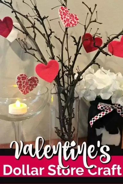 Valentine's Day tree with heart ornaments, mason jar painted with scottie dog amd lighted flameless candle on a mantel/