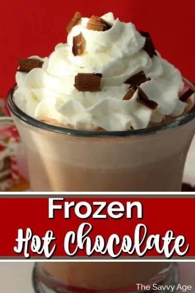 Mug of frozen hot chocolate with whipped cream on top and chocolate sprinkles.