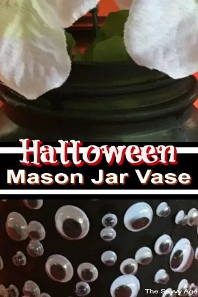 Black mason jar vase adorned with googly eyes for Halloween.