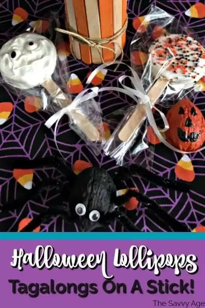 Black spider made from walnut, Halloween cookie Lollipops in orange and white decorated with Halloween sprinkles.