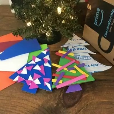 Cardboard box, tree ornaments painted and decorated with foam paper ornaments.