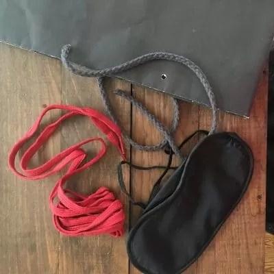 Red shoelaces, eye mask, shopping bag