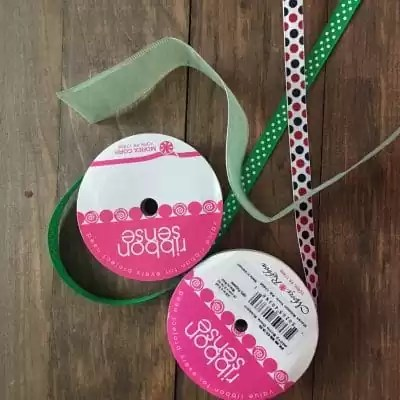 Satin ribbon polka dot red and black and green with white polka dots.