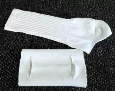 White athletic socks cut into a face mask.