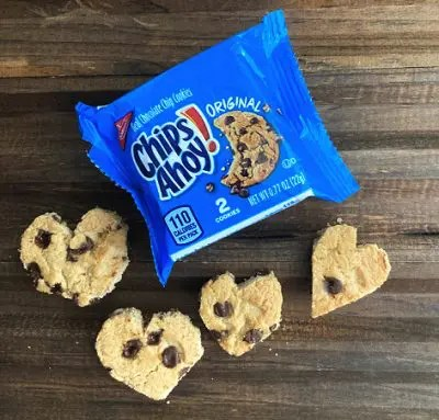 Package of chips ahoy cookies with cookies in a heart shape on a brown background.