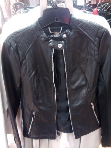 Leather Jacket hanging on a rack