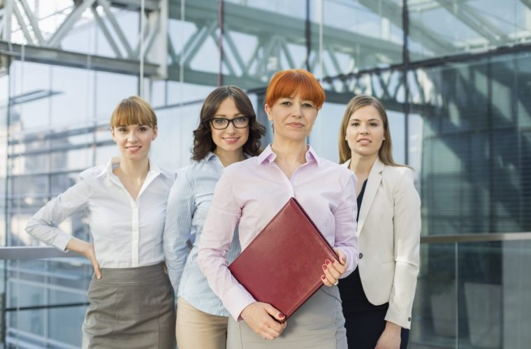 Portrait of confident businesswomen standing together in office