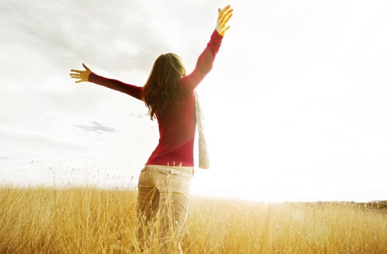 Happy woman in a field